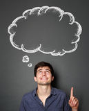 Man looking and pointing up to blank bubble speech Stock Image