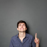 Man looking and pointing up to copy space Royalty Free Stock Images