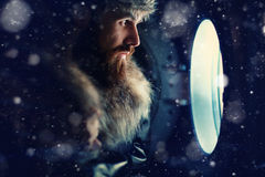 Man looking through  porthole of a ship Royalty Free Stock Photography