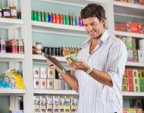 Man Looking At Product Royalty Free Stock Image