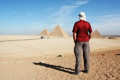 Man looking on pyramids Stock Image