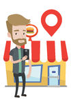 Man looking for restaurant in his smartphone. Royalty Free Stock Image