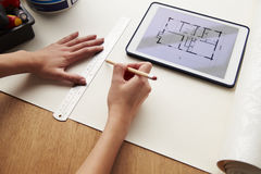 Man Looking At Room Plans On Digital Tablet Royalty Free Stock Photos