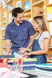 Man Looking At Saleswoman In Store Royalty Free Stock Images