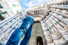 Man looking at the San Lorenzo cathedral in Genoa, Italy Stock Photo