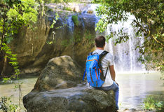 Man looking at scenic waterfall in Vietnam Stock Image