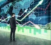 Man looking at the scoreboard with business chart Stock Image