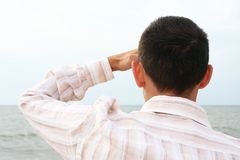 Man looking at the sea Royalty Free Stock Image