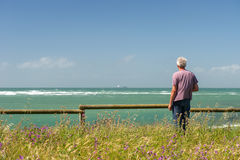 Man looking at the sea Royalty Free Stock Photo