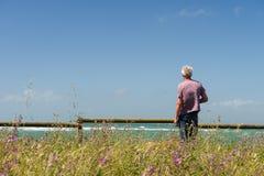 Man looking at the sea Stock Image