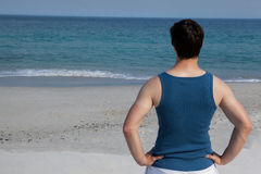Man looking at sea from beach Stock Image