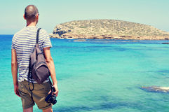 Man looking at the sea and the Illa des Bosc island, in Ibiza, S Royalty Free Stock Photo