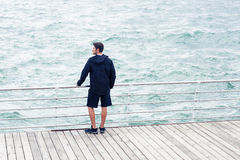 Man looking at the sea outdoors Royalty Free Stock Photo
