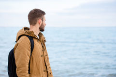 Man looking at the sea outdoors Stock Images