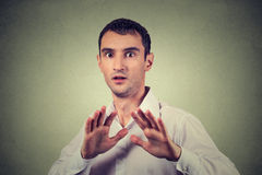 Man looking shocked scared trying to protect himself from unpleasant situation Stock Photo