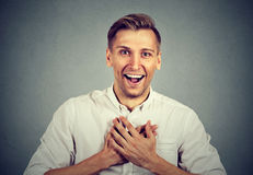 Man looking shocked surprised laughing hands on chest Stock Photos