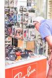 Man looking at a shop royalty free stock image