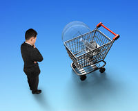 Man looking at shopping cart with light bulb top view Stock Photography