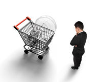 Man looking at shopping cart with light bulb top view Stock Photos