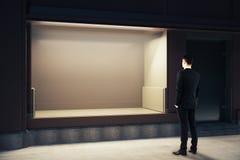 Man looking at showcase Stock Image