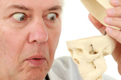 Man looking into the skull Stock Images