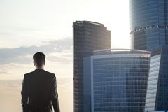 Man looking on skyscraper Royalty Free Stock Images