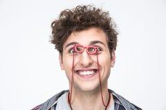 man looking through small glasses at camera Stock Photos