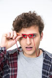 Man looking through small glasses at camera Royalty Free Stock Images