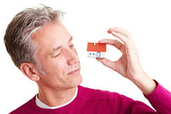 Man looking at small house Stock Photography