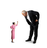 Man looking at small screaming woman Royalty Free Stock Images