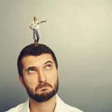 Man looking at small woman on the head Stock Image