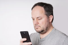 Man looking at smart phone Royalty Free Stock Photo