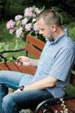 Man Looking at Smartphone Royalty Free Stock Image