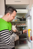 Man looking for something for cat Stock Image