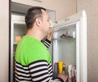 Man looking for something in refrigerator Royalty Free Stock Photography
