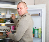 Man looking for something to eat Royalty Free Stock Photo