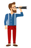 Man looking through spyglass Royalty Free Stock Photography