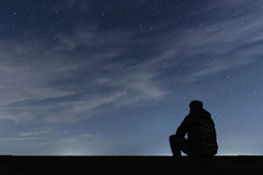 Man looking at the stars Royalty Free Stock Images