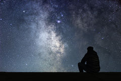 Man looking at the stars. Alone man looking at starry sky. Night sky Royalty Free Stock Image