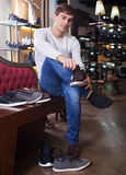 Man are looking for a summer shoes. Elegant man looking for a summer shoes royalty free stock photos