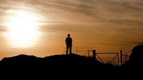 Man Looking At Sunset Stock Images