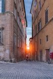 A man looking a sunset between buildings located to Jesy Italy royalty free stock photo