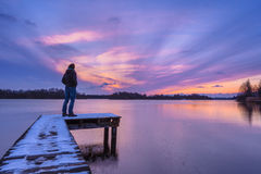 Man Looking at the Sunset From a Pier Royalty Free Stock Photography