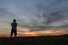 A Man looking at the sunset Stock Images