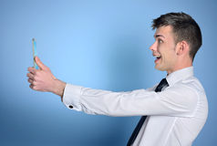 Man looking tablet. Business man happy looking tablet Royalty Free Stock Photos