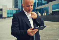 Man looking at tablet pc Stock Photo