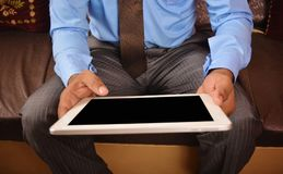 Man looking at tablet pc screen Stock Images