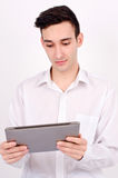 Man looking at the tablet. Stock Images