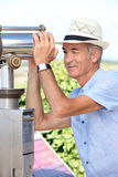 Man looking through a telescope. Senior man looking through a telescope royalty free stock images
