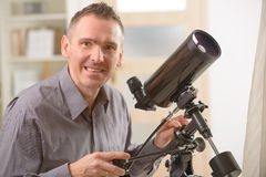 Man looking through telescope Royalty Free Stock Photo